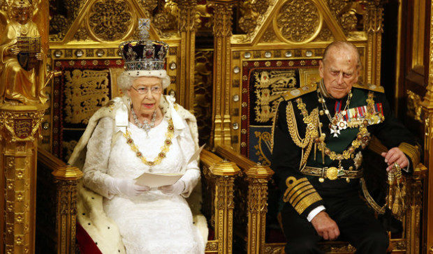 Britain's Queen Elizabeth II reads the Queen's Speech as Prince Philip listens during the State Opening of Parliament in the House of Lords in London, Wednesday, May, 18, 2016. The Queen will give a speech to parliament about the government's legislative programme for the upcoming parliamentary year. (AP Photo/Alastair Grant, Pool)