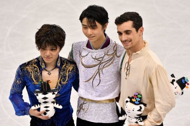 Japan's gold winner Yuzuru Hanyu (C) poses with compatriot silver winner Shoma Uno (L) and bronze winner Spain's Javier Fernandez (R) following the venue ceremony after the men's single skating free skating of the figure skating event during the Pyeongchang 2018 Winter Olympic Games at the Gangneung Ice Arena in Gangneung on February 17, 2018. / AFP PHOTO / Mladen ANTONOV        (Photo credit should read MLADEN ANTONOV/AFP/Getty Images)